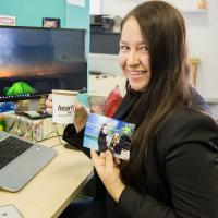 Lady Posing With Her Coffee And Photo From The Mediamark Marking Stunt