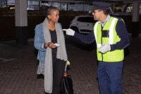 Officer Handing Out A Voucher, Instead Of A Traffic Fine, As Part Of Our Mediamark Ambush Marketing Stunt