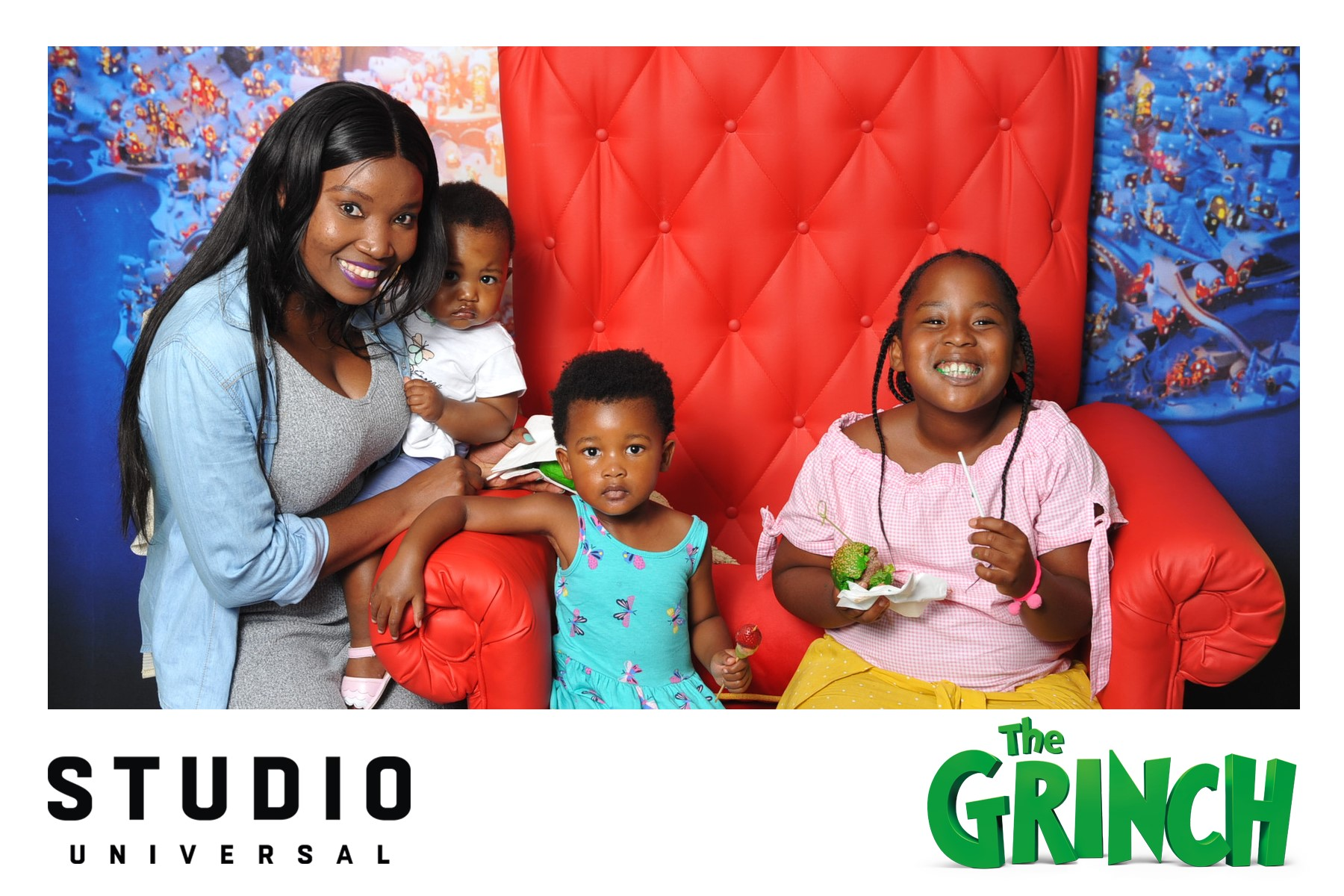 Photo booth fun at the Grinch exclusive movie screening