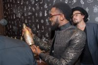 Choosing A Drink At The E! Entertainment 15 Birthday Celebration